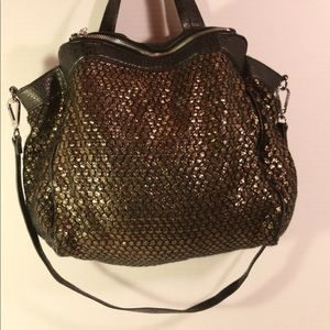 KELSI DAGGER COPPER TOTE BAG WITH LEATHER TRIM.